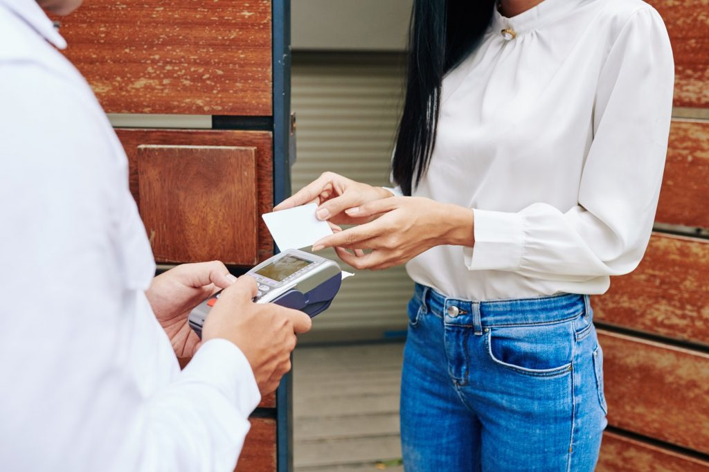 Woman Paying For Delivery
